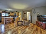 Warm hardwood floors line this charming home.