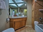 Freshen up for a night out in this full bathroom with a shower/tub combo.