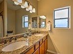The shared second bathroom has a double-sink for ample space.
