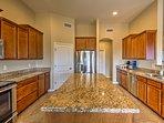 Granite countertops complete the kitchen's luxurious look.