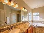Relax in the en-suite master bathroom's soaking tub.