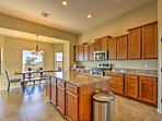 Prepare meals in the fully equipped kitchen with stainless steel appliances.