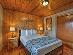 Warm wood furnishings create a cozy atmosphere in the second bedroom.