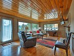 Pine-paneled ceilings echo the natural beauty that surrounds this home.