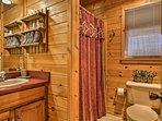 The cabin has 2 full bathrooms.