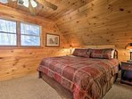 Head upstairs, where you'll find a king bed in this room.
