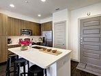Kitchen has contemporary dark wood cabinets.