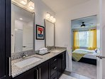 The master bath also features his-and-hers vanity mirrors and sinks.