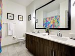 Guest bathroom with double sinks.