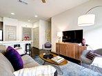 Living room has a brand-new 48' flat screen TV.