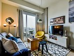 Living room with 48' flatscreen ROKU TV.