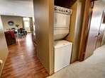 In unit washer/dryer with detergent and fabric softener provided, as well as ironing board and iron