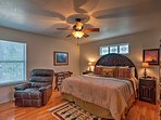 Retreat to the master bedroom and rest on the king-sized bed.