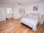 Bright spacious double en-suite bedroom is Downstairs.