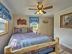 The master bedroom features a cozy queen bed.