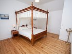 Main bedroom is huge with great  sea views and features genuine hand make 4poster King Size Bed.