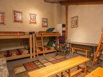 Knotty Pine-Bunk room with six twins , table and seating area