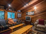 Knotty Pine-Seating area in bunk room with TV