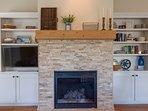 A gas fireplace and HDTV are the focal point of the great room.