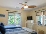 The 2nd guest bedroom on the first floor has twin beds and an HDTV.