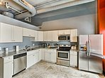 The stainless steel appliances complement the granite countertops.