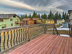 Breathe in the fresh mountain air while relaxing on the home's back deck.