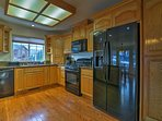 Modern appliances and ample counter space make home-cooking feel effortless.