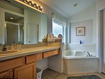 Go for a soak in the Jacuzzi tub in the en-suite bathroom.