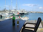 Have a cool drink in the shade of a parasol while watching the boats at Latchi.