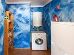 Kitchen storage area including fridge and washing (clothes) machine