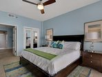Spacious master bedroom with king sized bed and full gulf view