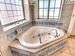 Jacuzzi tub in the en-suite Master bath .