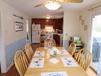Open kitchen and dining area with sliders to the backyard and deck on the right- 17 Woodbine Road Harwich Port Cape Cod...
