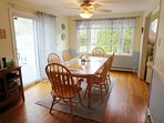 Dining area with sliders to deck- 17 Woodbine Road Harwich Port Cape Cod New England Vacation Rentals
