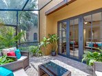 Just outside the living room's French doors, you'll find this private little oasis, a fully screened courtyard sitting...