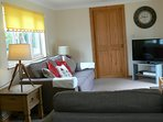 lounge, television with sky movies/sports dvd player. patio door leading to garden