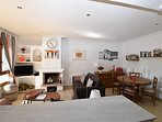 The living room with dining table, sofas, TV, chromcast, wifi, British TV stations, DVD Player,
