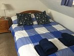 2nd floor Bedroom 2 Attic room - Double bed with 2 pull out single beds, (if required), TV/DVD/WiFi.