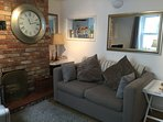 Lounge with comfy seating, lovely interior,  tv/dvd/wifi, leads directly into kitchen/dining room.