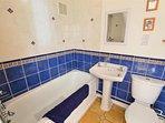 Bathroom with over- bath shower