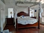 King-size Bassett canopy bed with mosquito net