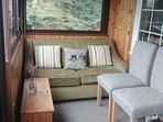 Sofa bed in the sun room with mountain views