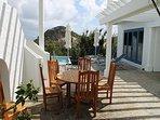 Teak table on pool deck for alfresco dining