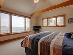 Master bedroom with king bed and water view