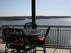 Screened in deck with new bar height patio set.No docks to obstruct your view.You can see for miles!