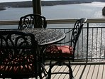 New bar height patio set on screened in wrap around patio. No docks to obstruct your view!