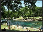 Swim at Barton Springs Pool 15- 20 minute walk away or 5 minute bike ride