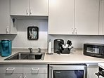 Brew a fresh cup of coffee from the blue Keurig machine!