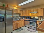 The fully equipped kitchen's stainless steel appliances make cooking a breeze.