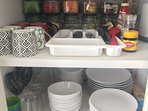 Diningware, oven, stove top, fridge, microwave, kettle, toaster, tea & coffee, basic pantry items.